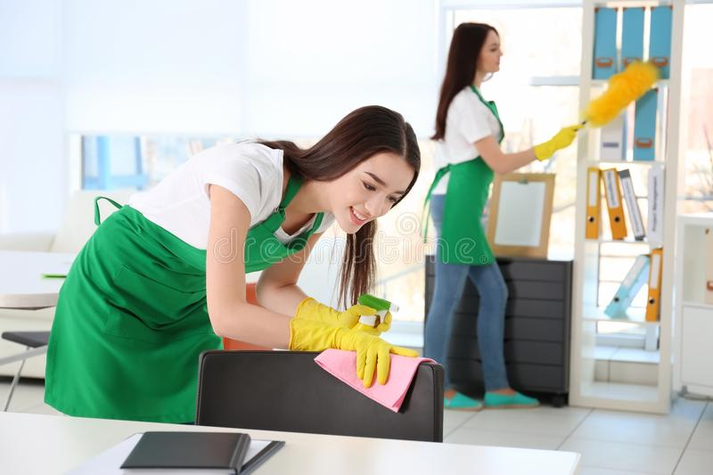Cleaning service team working stock photo