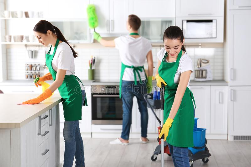 Cleaning service team working royalty free stock images