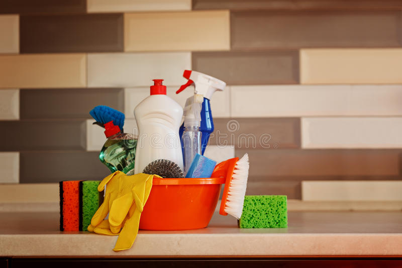 Cleaning set with products and supplies on kitchen table stock photography