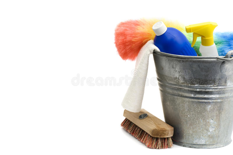 Cleaning supplies. Bucket, spray bottle, detergent, rug, scrubber, duster - isolated on white stock image