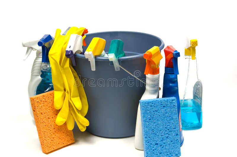 Cleaning supplies. On white background including several spray bottles of chemicals, a bucket, gloves and sponges royalty free stock image