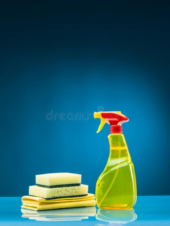 Cleaning supplies. Against blue background royalty free stock image