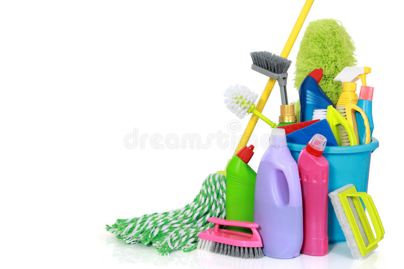Cleaning supplies in bucket. Plastic bucket with cleaning supplies isolated on white background stock photography