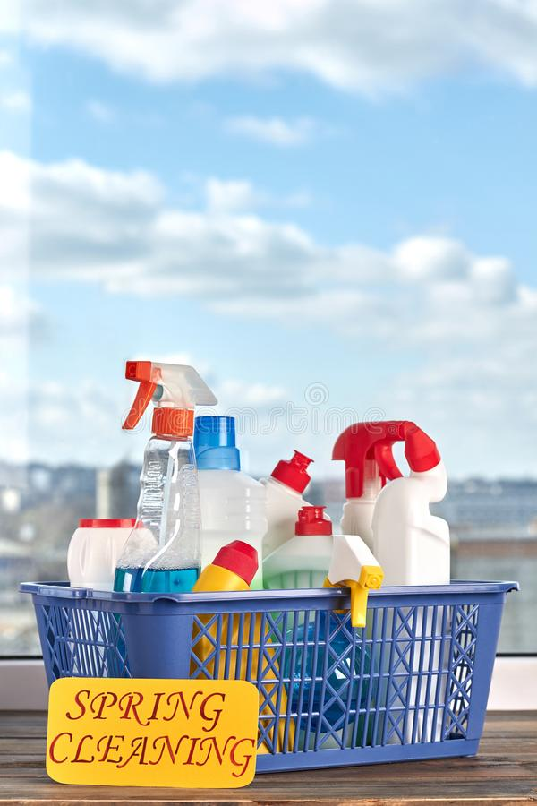 Cleaning supplies kit in basket. stock photos