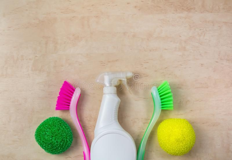 Cleaning supplies and products on wooden background, housework concept, top view with copy space royalty free stock photo