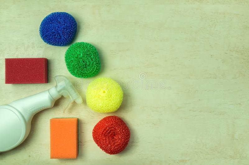 Cleaning supplies and products on wooden background, housework concept, top view with copy space stock images