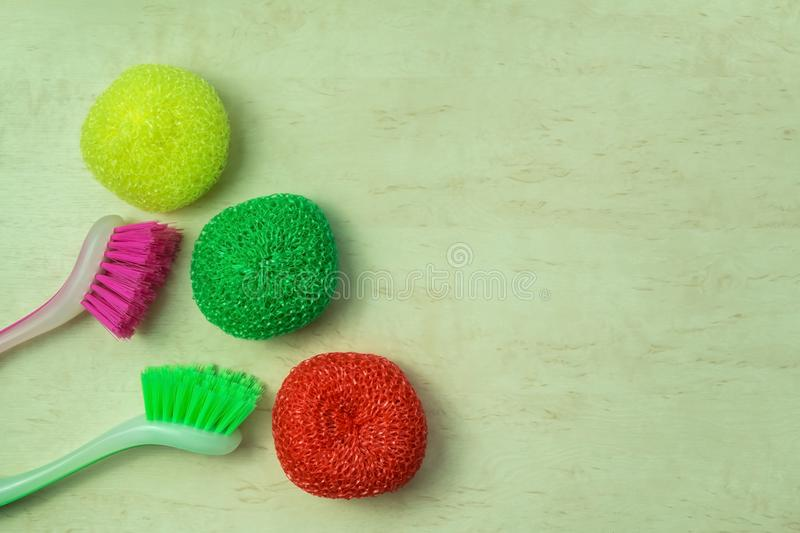 Cleaning supplies and products on wooden background, housework concept, top view with copy space stock image