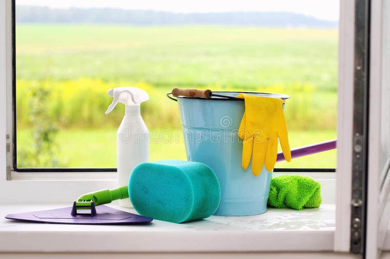 Cleaning supplies on the windowsill stock photography
