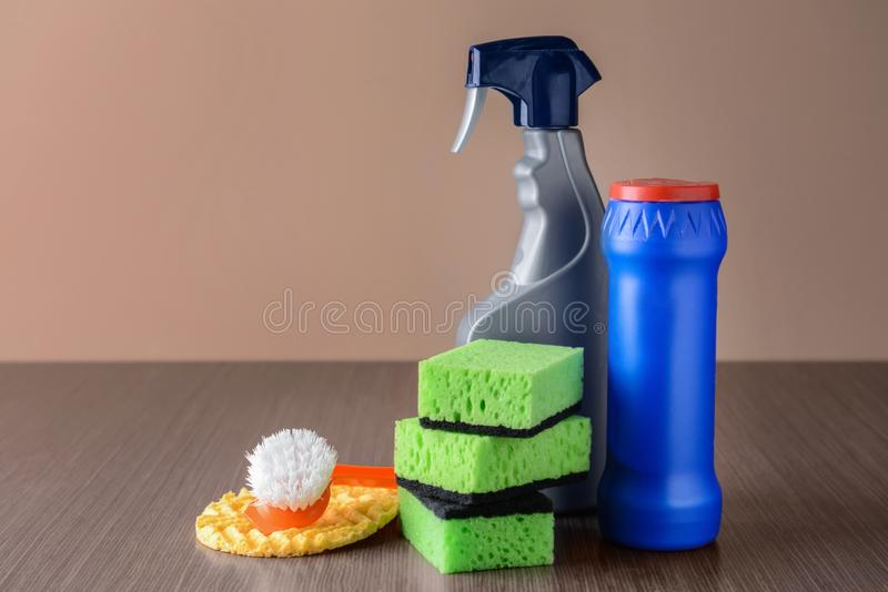 Cleaning supplies on wooden table stock photo