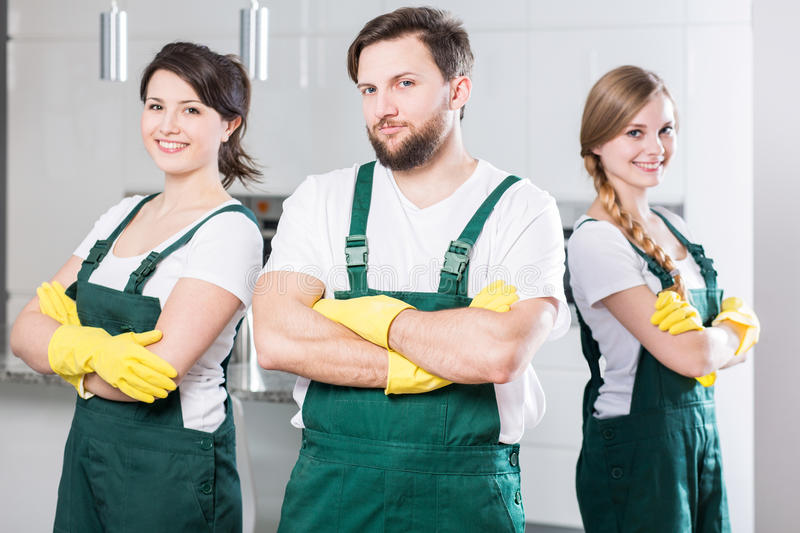 Cleaning team ready to clean the dirtiest room royalty free stock photo