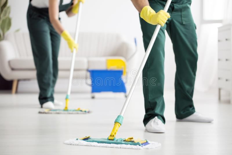 Cleaning team wiping the floor royalty free stock images