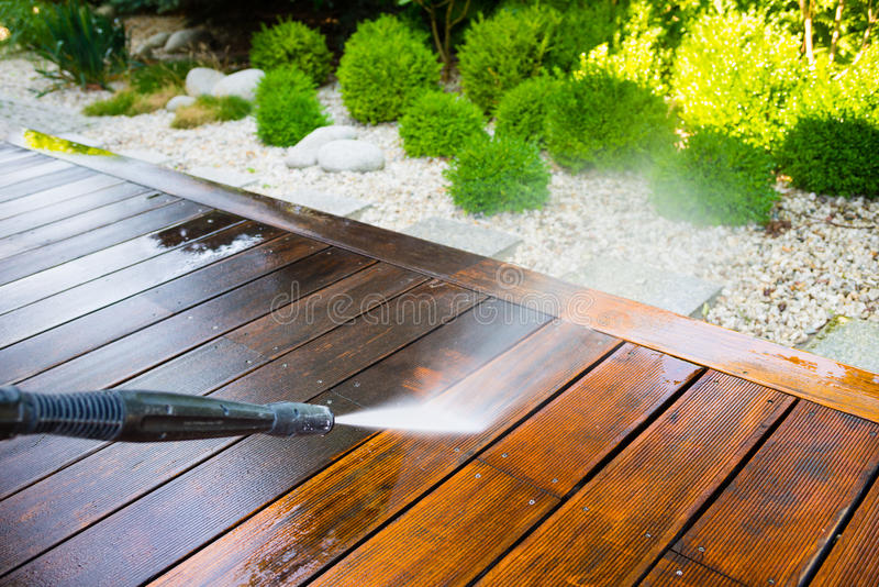 Cleaning terrace with a power washer stock photo