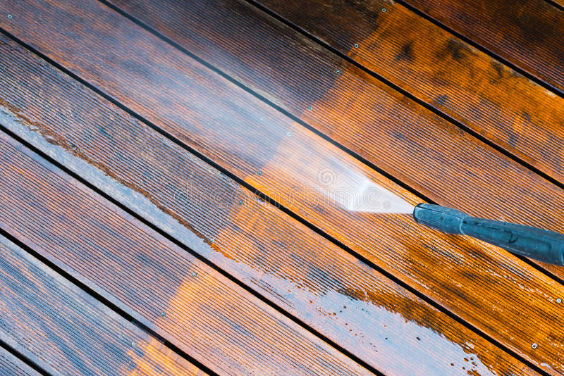 Cleaning terrace with a power washer stock images