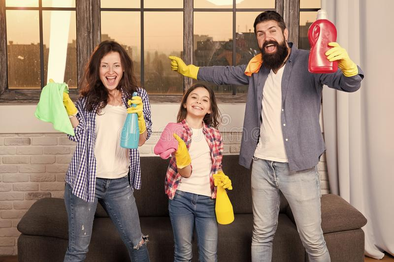 Cleaning together easier and more fun. Family care about cleanliness. Start cleaning. Cleaning day. Family mom dad and. Daughter with cleaning supplies at stock images