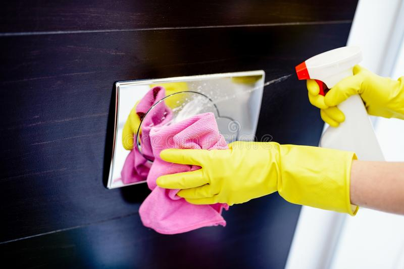 Cleaning toilet flush button stock photos