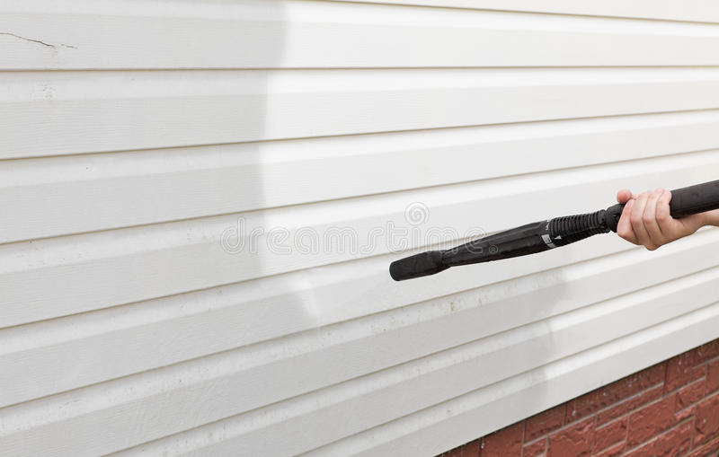 Cleaning the wall. (vinyl siding) high pressure cleaner stock photos