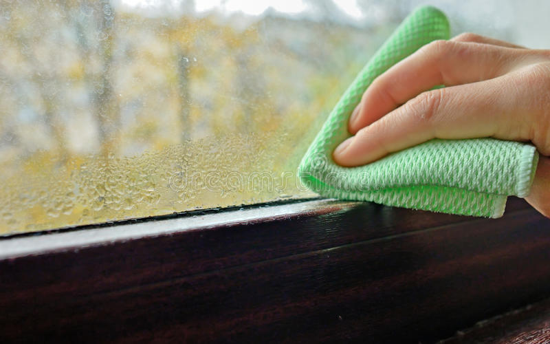 Cleaning water condensation on window royalty free stock photography