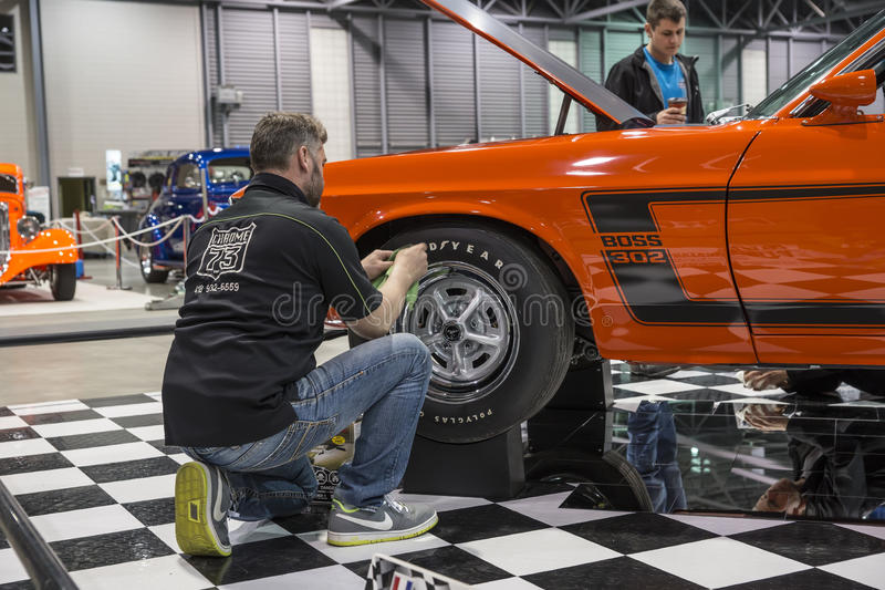 Cleaning the wheel. Picture of the man cleaning the wheel of the boss 302 mustang at the international show car association 2013. Isca show car 2013 at quebec stock images