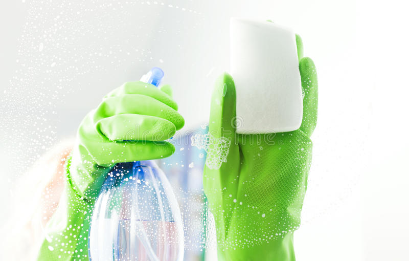 Cleaning window pane with detergent stock photos