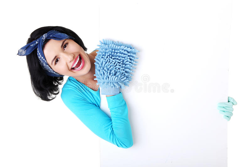 Cleaning woman showing blank sign board. stock photos
