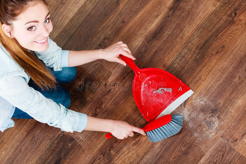 Cleaning woman sweeping wooden floor stock images
