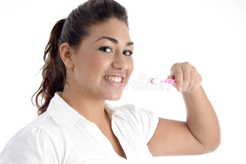 cleaningflicka henne unga tänder royaltyfria foton