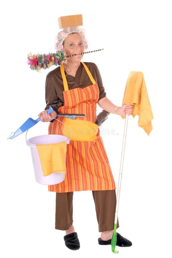 cleaninghemmafru arkivbild