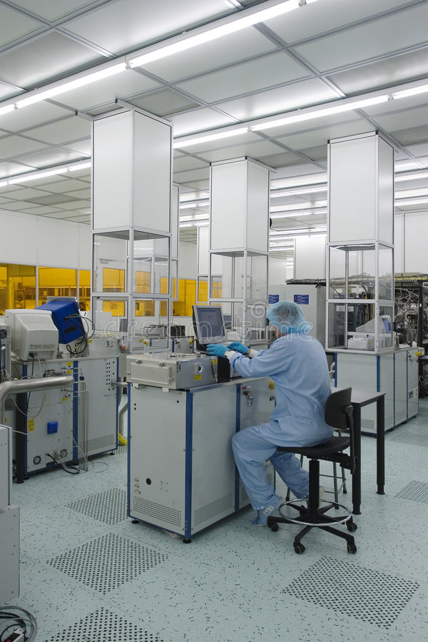 Cleanroom IV. Work in the controlled environment of a high tech research cleanroom royalty free stock photos
