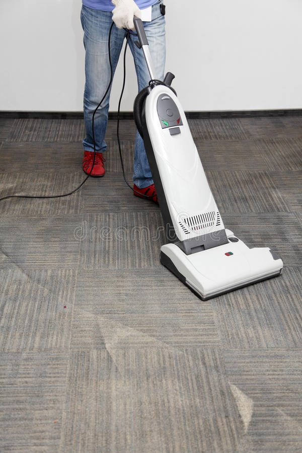 Cleans the carpet royalty free stock photos