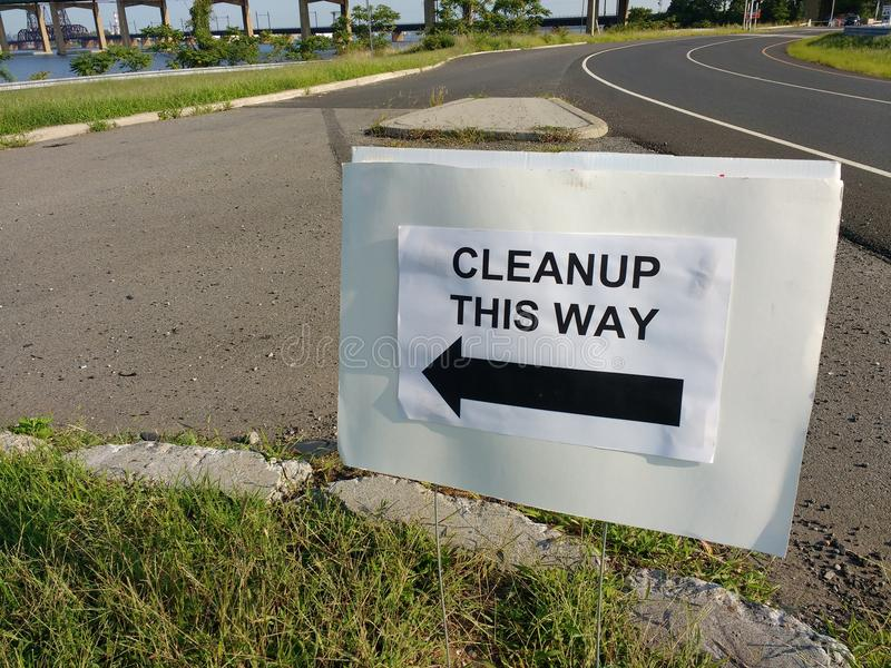 Cleanup This Way, Sign Directing Volunteers. This sign directs cleanup volunteers to the meeting point for the event. This photo was taken in Bayonne, New Jersey stock photography