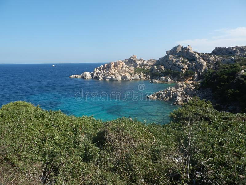 Clear amazing azure coloured sea water with granite rocks.  stock photo