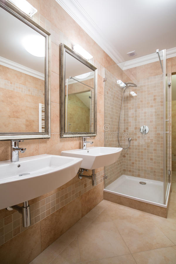 Clear and beige bathroom. In the house royalty free stock photos