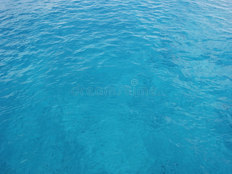Clear Blue Ocean Water. In Cozumel, Mexico. This works great for a background image. Shot on a sunny clear day. You can see the bottom through the clear blue royalty free stock photos