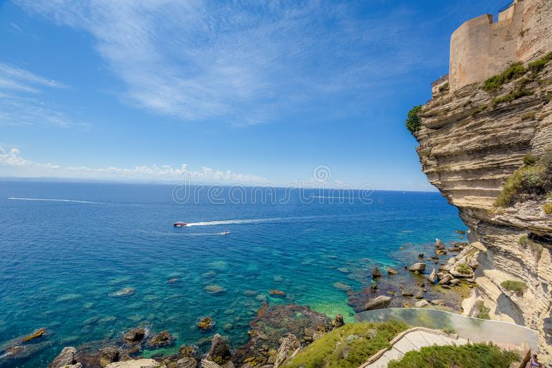 Clear blue sea with high cliffs. stock photo