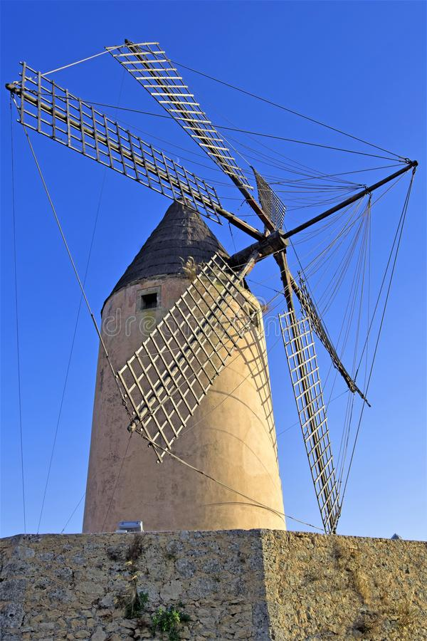 Majorca Windmill in full view, at Santa Ponca, Majorca, Spain. A clear blue sky amd ambient lighting at dusk, helped to capture this well preserved traditional royalty free stock photos