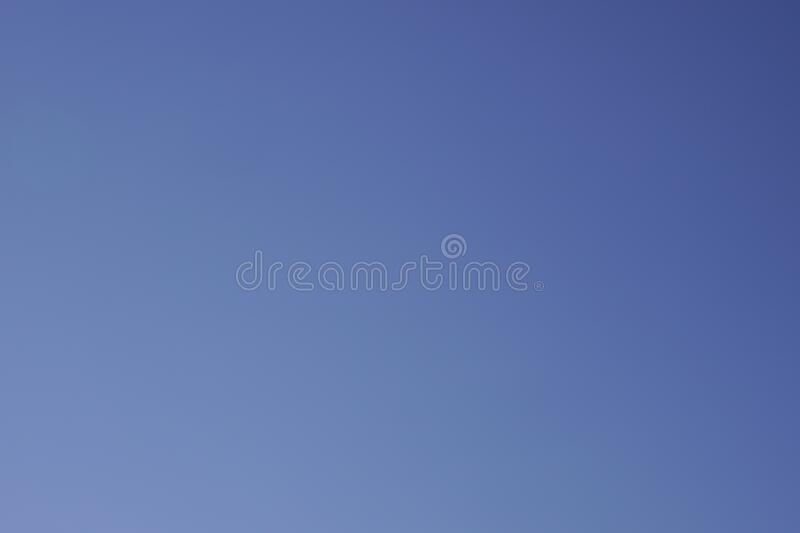 Clear blue sky background on a sunny day royalty free stock photo