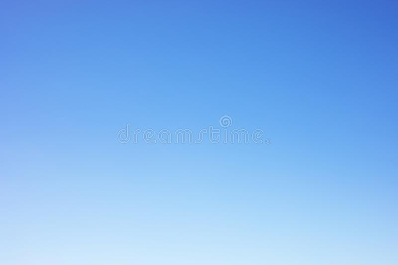 Clear blue sky background and empty space for your design, no cloud stock photography