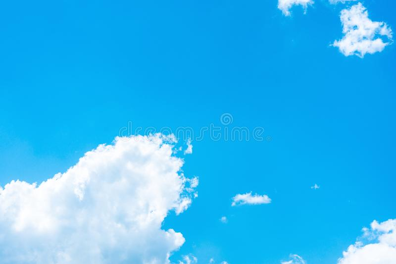 Clear Blue Sky with Big And Small Fluffy Transparent White Clouds in the Corner. Purity Heaven Meditation Concept royalty free stock photo