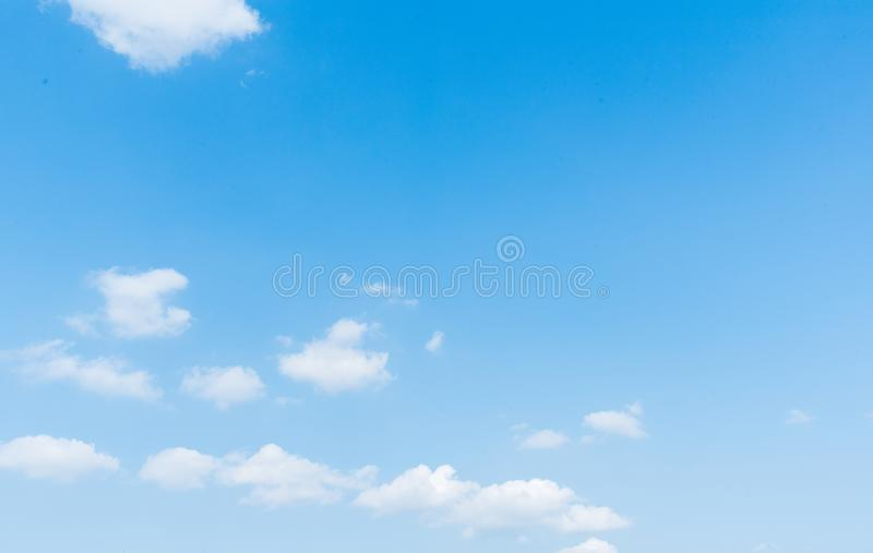 Clear blue sky with cloud background. stock image
