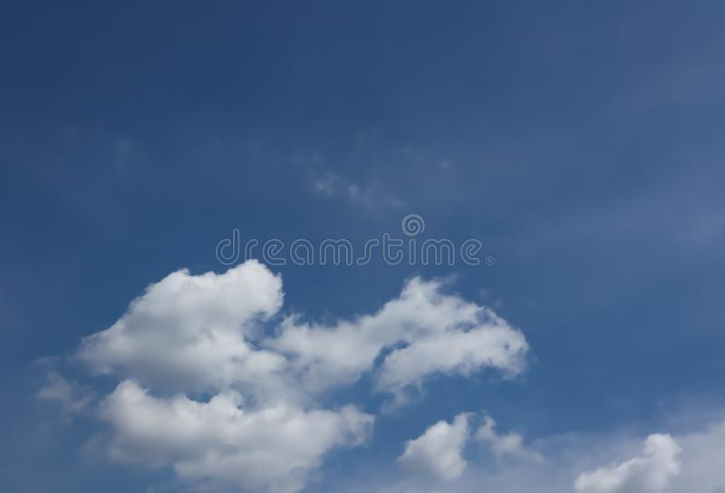 Clear blue sky with cloud background. White, Fluffy Clouds In Blue Sky. Copy space royalty free stock images