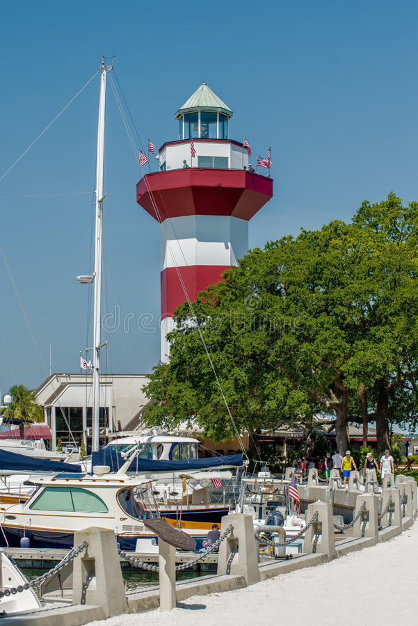 A clear blue sky features the Harbour Town Lighthouse - famous l stock photos