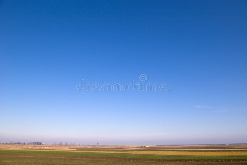 Clear Blue Sky Horizontal. Beautiful blue sky and a country field stock image