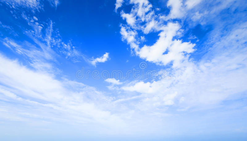 Clear blue sky with plain white cloud with space for text. royalty free stock photography