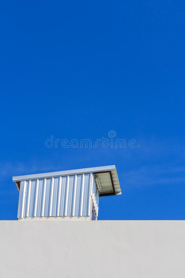 Clear blue sky with rooftop royalty free stock images