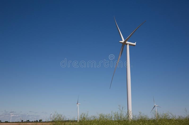 Big Field of Wind Turbines on a Sunny Day stock photos