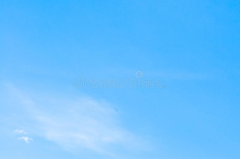 Clear Blue sky with thin clouds royalty free stock photos