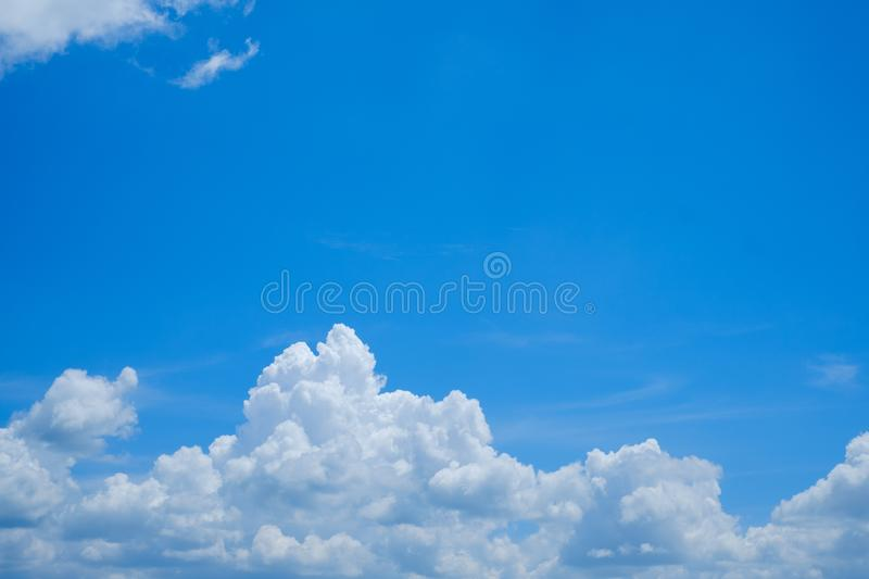 Clear blue sky with white cloud for background backdrop use and postcard, wall paper stock photos