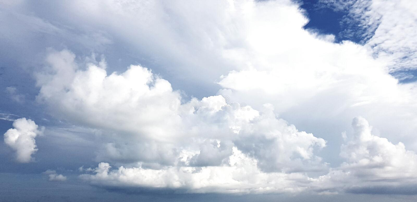 Clear blue sky with white cloud background. Clearing day and Good weather in the morning.  stock photography