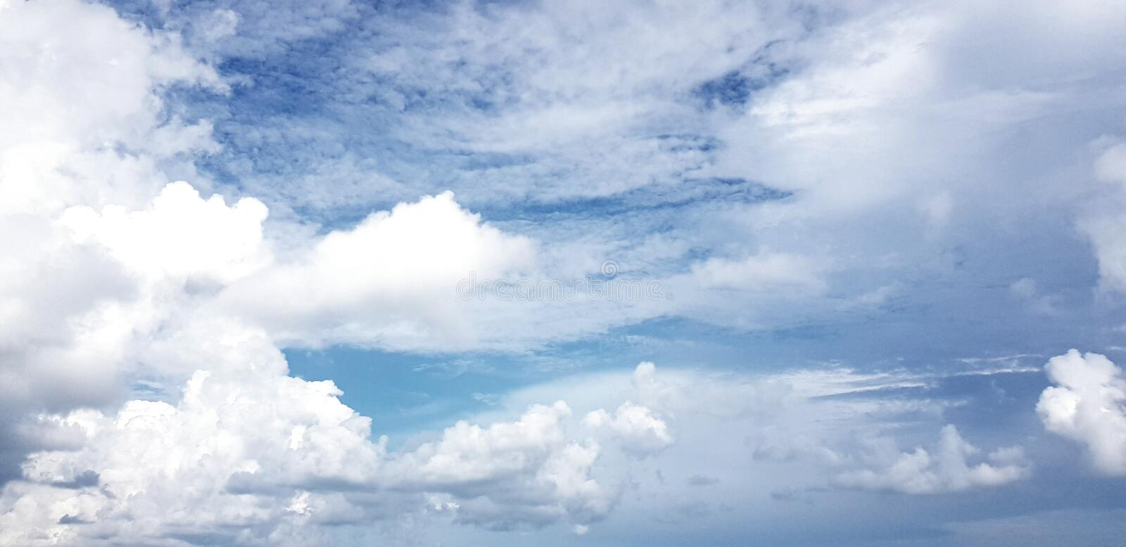 Clear blue sky with white cloud background. Clearing day and Good weather in the morning.  royalty free stock photos