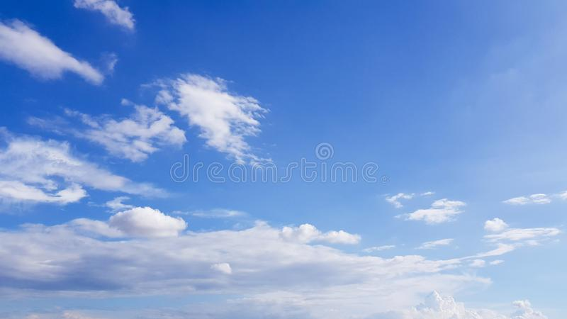 Clear blue sky with white cloud background. Clearing day and Good weather in the morning.  royalty free stock photo